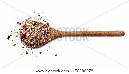Homemade Herb and Spices Salt with Dried Chili Pepper Rosemary Thyme and Coriander in Wooden Spoon isolated on White background