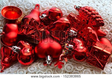 Traditional decoration: snowflake red bells heart cone for fir tree on wood box with snow white napkin. Christmas or New Year concept. Winter festive background.