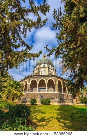 Dome and colonnade surrounded by a park. Catholic monastery and a small church Mount Beatitudes. Israel, Sea of Galilee Beach