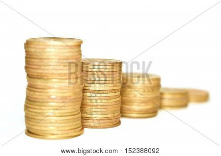 Golden Coins stacked on each other on white background. Macro