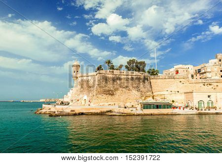 watch tower and the walls of Valletta at Gardjola Gardens in Senglea, Malta