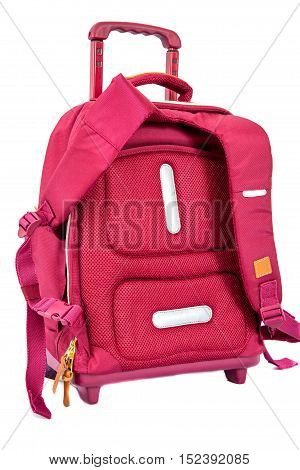 children's school trolley bag red color. isolated