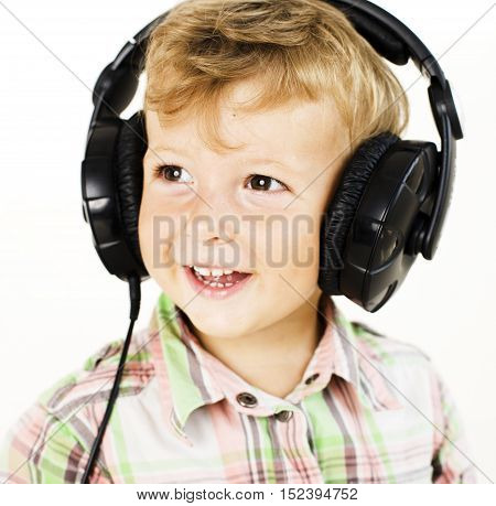 portrait of little cute boy in big earphones happy smiling isolated on white background, lifestyle people concept close up