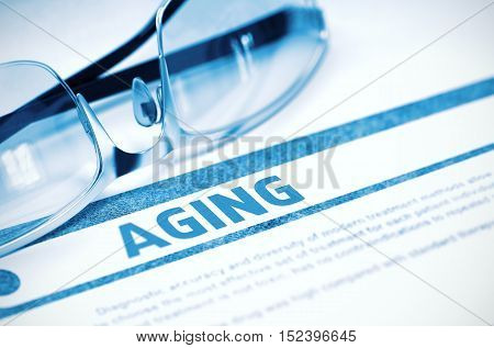 Aging - Medical Concept on Blue Background with Blurred Text and Composition of Pair of Spectacles. 3D Rendering.