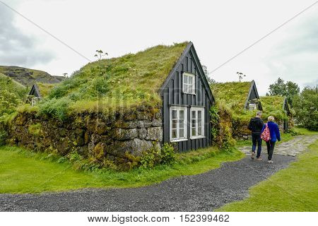 SKOGAR, ICELAND - AUGUST 12, 2016: Traditional Icelandic houses in Skogar. This area is known for the waterfall Skogafoss and the folk museum exhibiting traditional buildings.