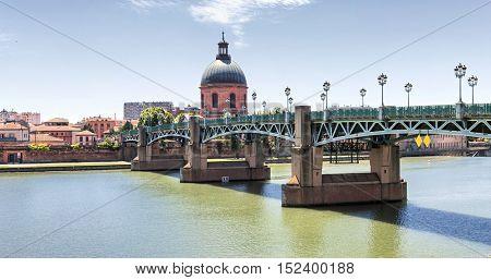 Panoramic view of Saint-Pierre Bridge over Garonne river and Dome de la Grave in Toulouse, France