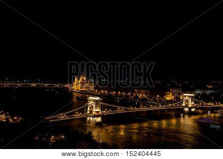 Chain Bridge over the Danube with Hungrian Parliament in background illuminated at night Budapest Hungary - 23 Sep 2016