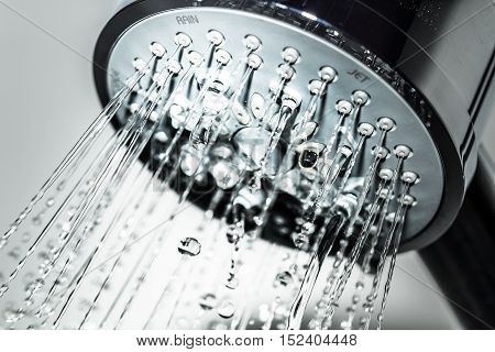 Shower Head with Water Stream on Grey Background