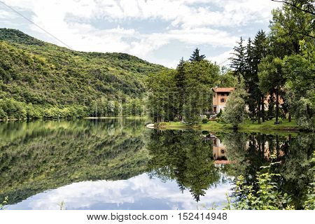The lake of Ghirla (Varese Lombardy Italy) in a summer morning