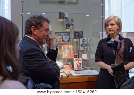 ST. PETERSBURG, RUSSIA - OCTOBER 7, 2016: People in the exhibition dedicated to 85th anniversary of Russian author Julian Semyonov in the Presidential library. People call him The Consummate Insider