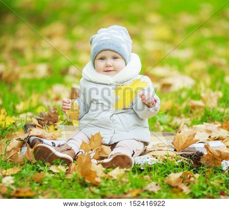 happy baby girl in the autumn park