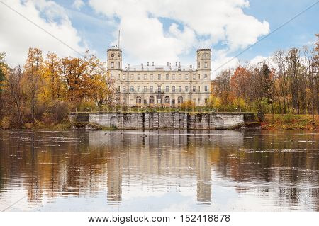 GATCHINA SAINT PETERSBURG RUSSIA - OCTOBER 16 2016: The Great Gatchina Palace and reflected in the Pond. The Gatchina Palace was one of the favourite residences of the Imperial family.