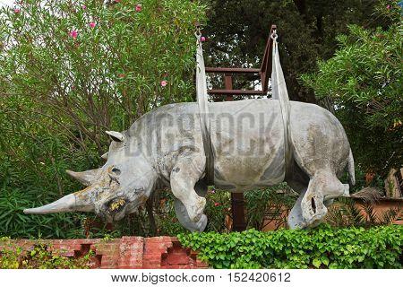 LIGURIA, ITALY - SEPTEMBER 2016 : Status of suspended rhinoceros rhino sculpture hanging above the Marina di Portofino in Portofino, Liguria, Italy Northern Europe on September 23, 2016.