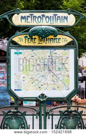 Paris France - July 11 2016: The entrance to the Pere Lachaise metropolitain station with the parisian metro map. It is a famous Art Nouveau symbol designed by Hector Guimard.