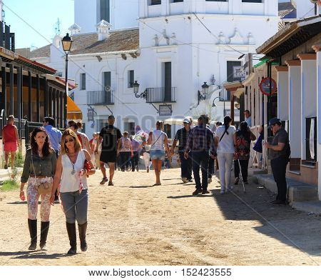HUELVA/SPAIN - 9 OCTOBER 2016: Piligrims going to the Sunday holy mass at the shrine of El Rocio