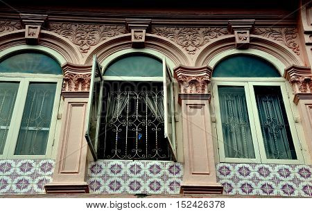 Phuket City Thailand - January 8 2011: Restored late 19th century Sino-Portuguese shop house with tiles ornamental pilasters and arched windows on Soi Rommanee