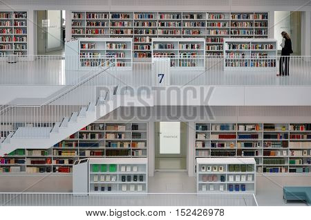 STUTTGART, GERMANY - APRIL 16, 2015: White interior of a modern city library. The floors of books connected by a staircase. Stadtbibliothek, Stuttgart, Germany on April 2015.