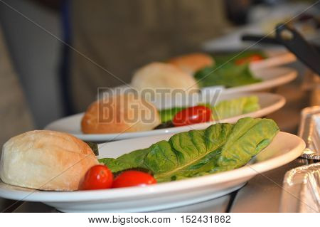 food prep line plated roll tomato lettuce