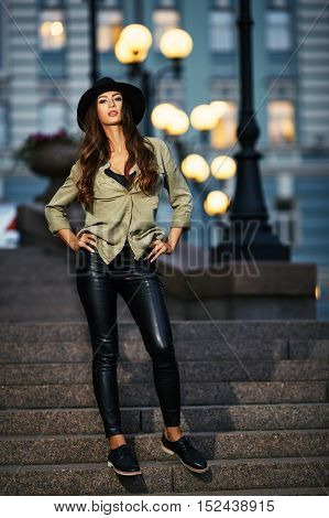 Full Length Portrait Of Attractive Elegant Young Woman With Black Hat Standing On The Stair, Street