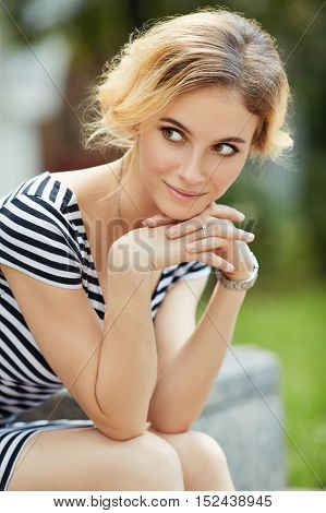 Outdoor Portrait Of Beautiful Blonde Young Woman
