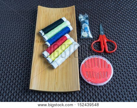Sewing equipments. Accessories for needlework on wooden.