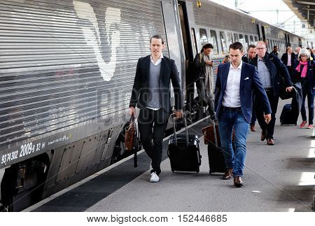 Gothenburg, Sweden - May 25, 2015: A high-speed train type X2000 operated by SJ has arrived at Gothenburg Central Station with arriving passengers who have disembarked and goes along with the platform.