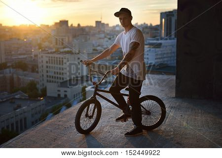 Boy Resting With His Bmx After Practicing In The Bowl