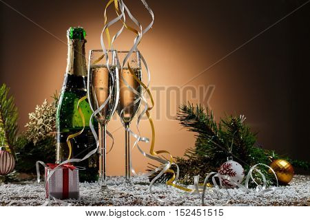 Champagne glasses, Christmas balls, gift and other symbols of holiday