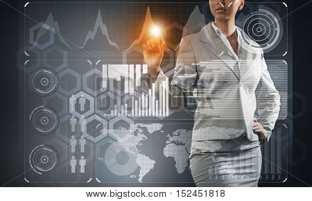 Close up of businesswoman touching virtual panel with finger