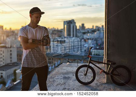 Portrait Of Young Bmx Rider With His Bike