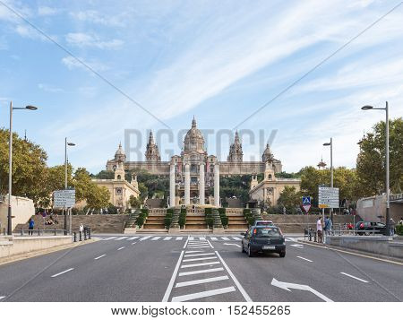 Barcelona - 10 October 2015: The road to the National Museum of Catalonia and people walk October 10 2015 Barcelona Spain
