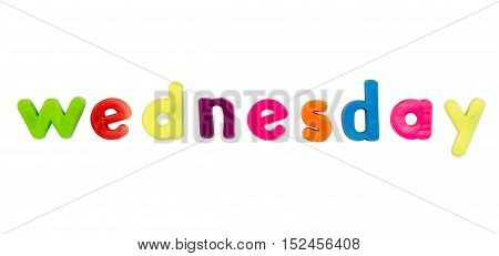 Plastic multicoloured plastic letters with the word Wednesday