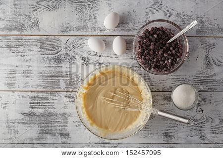 Ingredients for baking cake on white table