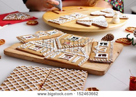 Making of christmas gingerbread house. Walls decorating.