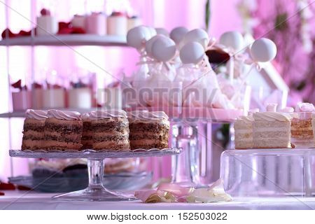 table setting in a restaurant preparing for the holiday instruments and sweets