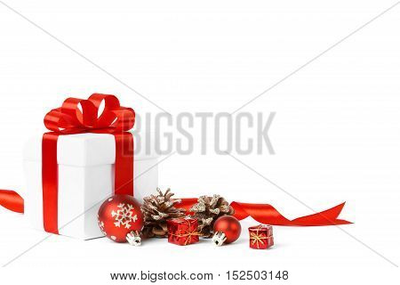 Colorful red gifts with Christmas ornamental isolated on white