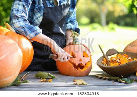 preparation for the celebration of Halloween pumpkin carving faces in