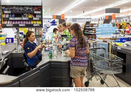 CYPRUS, PROTARAS, SUPERMARKET LIDL - 12.10.2016: Customers paying for shopping at a supermarket. Line at the cashdesks in the supermarket