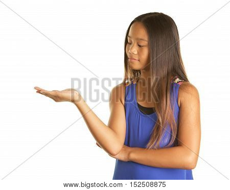Cute Filipino Girl on a White background  wearing a tank top.  She is holding her hand out with her palm up and looking at it as if something is in it.