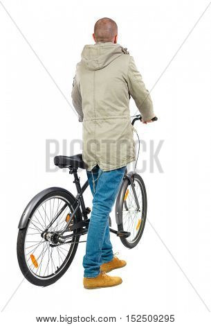 back view of a man with a bicycle. Cyclist in parka jacket keeps the wheel of a bicycle. Rear view people collection.  backside view of person. Isolated over white background.
