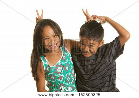 Cute Filipino Boy and Girl Twins being silly and happy on a white background