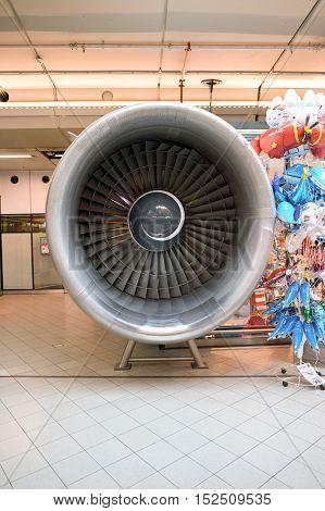 AMSTERDAM, NETHERLANDS - CIRCA NOVEMBER, 2015: plane engine at Schiphol Airport. Amsterdam Airport Schiphol is the main international airport of the Netherlands.