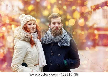 holidays, winter, christmas, tourism and people concept - happy couple in warm clothes walking in old town