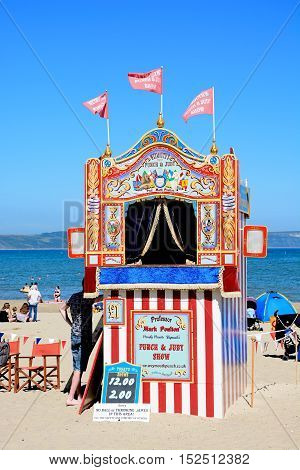 WEYMOUTH, UNITED KINGDOM - JULY 18, 2016 - Colourful Punch and Judy Show hut on the beach Weymouth Dorset England UK Western Europe, July 18, 2016.