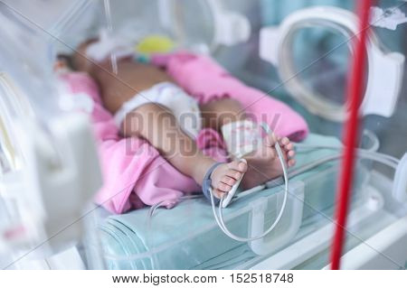 Newborn baby in hospital post-delivery room Respirator