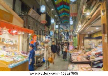 Blurred background. People shopping in Nishiki ichiba market. Nishiki ichiba market is a famous market in Kyoto Japa