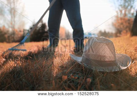 man with a lawn rake cleans the country of excess debris