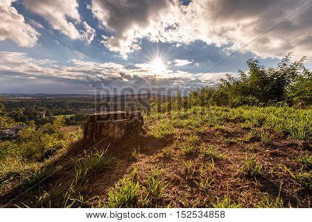 Hill bathed in sunshine and a tree stump. Moravian landscape Svitavka.