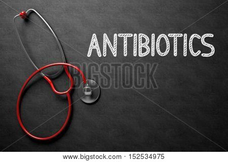 Medical Concept: Antibiotics - Medical Concept on Black Chalkboard. Medical Concept: Antibiotics - Text on Black Chalkboard with Red Stethoscope. 3D Rendering.