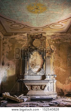 Demolished old church altar with pieces laying everywhere.